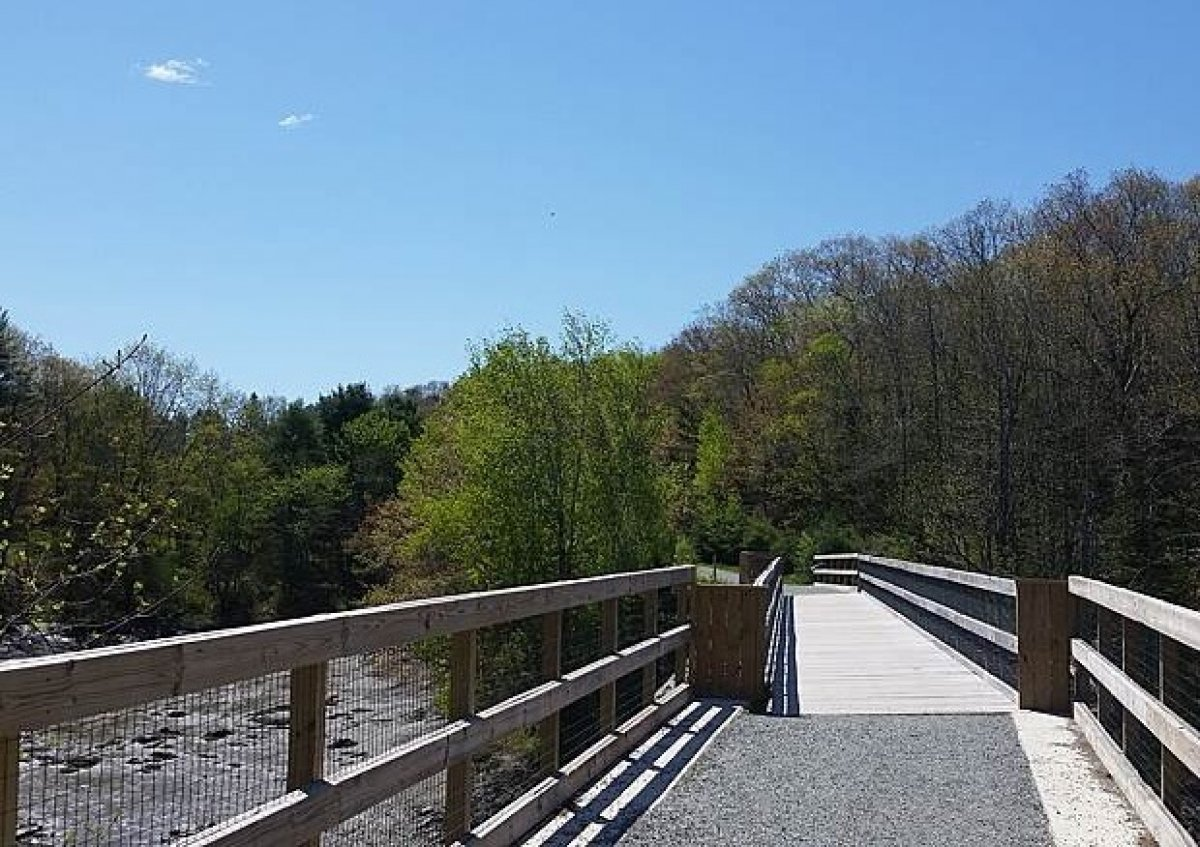 Scene of  bridge over water on the Belfast Rail Trail. Image from traillink.com